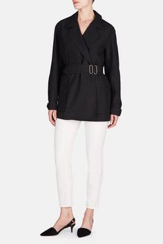 Nuanced asymmetry—barely visible at the hem—is enough to add immediate intrigue to this notch-collared jacket from the spring 2016 Lemaire collection. In lightweight Italian wool, the long, loose shape can be modulated by the topstitched belt: its bronze-toned metal double buckle is the piece's lone embellishment. Functional details such as generously sized flap-top patch pockets and corozo button cuffs hint at the label's enthusiasm for uniform dressing. But, says co-designer Sarah Linh…