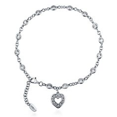 This anklet's delicate design will add a simple elegance to every wardrobe. Made of rhodium plated fine 925 sterling silver. Heart charm measures 0.5 inch L x 0.5 inch W. Anklet measures 9 inch with 1 inch extension in length, 3mm in width. Set with 3.07 carat round cut cubic zirconia in bezel setting. Nickel free.