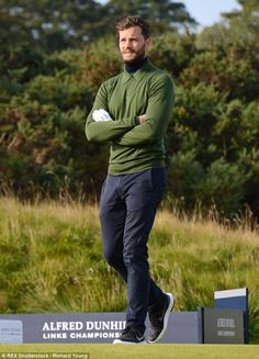 :) Taking it all in his stride:Jamie Dornan looked typically handsome at the golf tournament in Kingsbarns