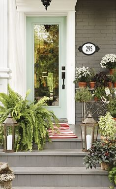 mint door + layered planters + painted brick