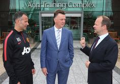 First day at the office: @manutd manager Louis van Gaal meets Ryan Giggs and executive vice chairman Ed Woodward on his first day at the Aon Training Complex.