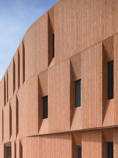 Vertical Masonry And Deep Window Recesses Give A Bold Appearance To This New Cultural Centre Building
