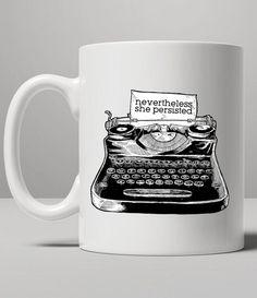 https://thepodomoro.com/collections/coffee-mugs-and-tea-cups/products/nevertheless-she-persisted-typewriter-mug-tea-mug-coffee-mug