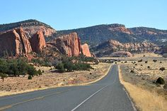 10 great all-American road trips  Dine' Tah Scenic Road  Arizona    Indulge your wanderlust on wheels while exploring Arizona's Wild West. It doesn't get more all-American than the Navajo Nation's ancestral lands: Whiz by sacred mountains, canyons, forests, and desert vistas, and stop off to peruse the wares of talented local artisans or to ogle ancient cliff dwellings and prehistoric drawings.