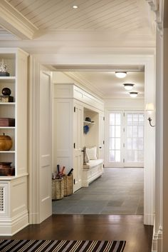 open mudroom, french door, wide doorway into kitchen or family room (in other words: i die.) john b. murray architect