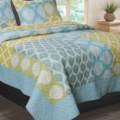 Outfit your master suite or guest room in eye-catching style with this charming quilt set, showcasing a textured design and an ogee-inspired motif.