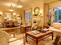 Traditional Living Room with Ethan allen giles chair, Cement fireplace, French doors, Wall sconce, Hardwood floors