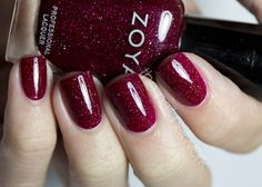 Zoya Blaze - cool-toned medium mulberry red with a high concentration of micro fine diamond holographic glitter. Rather than a true red, it appears more of a kind of purple.