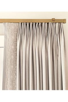 Pairing beautiful neutral custom draperies with gold traverse rods bringing a minimal ring-free look to windows. / Draperies: @ellasdesigns #windowtreatment #draperyhardware #brassrods #curtainrods #drapes customdraperies #traverserods