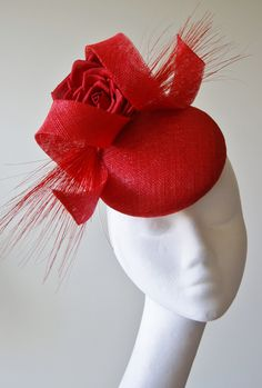 Elegant red sinamay hat with curl & rose trim from Esther Louise Millinery.