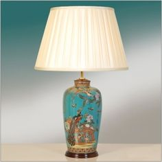 Elstead Lui's Turquoise Peacock Table Lamp 82PT/LB40  This artistic table lamp would look stunning in a living or dining space or on a console table in an entrance hall and is perfect for traditional or Asian-themed decors. The vase is decorated with an array of exquisite peacocks, birds and flowers in autumn colours on a vibrant turquoise background.