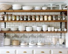Open shelving in the kitchen is my favorite! Not only is it stunning, I find it incredibly convenient. I love using oversized mason jarsfor flour, sugar, cereals, spices, etc. where they are easily accessible and look super pretty! Display cake stands, old jars, and stack everyday dishes to combine beauty and functionality. Here are some different bracket options for open shelving! From black iron, to brass, to painted wood, there are a lot of different combinations to achieve your perfect… Upper Cabinets, Shelving, Home Depot, Times, York, Kitchen Decor, Design, Shelves, Shelving Units