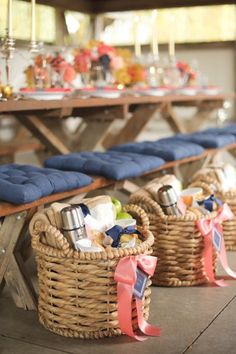 Wicker picnic gift baskets for guests.  The peach, coral, and blue color scheme is so refreshing for summer.