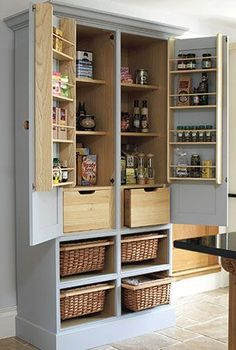 No pantry space? Turn an old tv armoire into a pantry cupboard. Awesome! - sourced by Uli Philps @Neat4Ever
