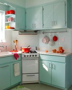 Nothing creates visual clutter quite like a clash of color in the kitchen. Select one solid hue to marry the space's various components in lieu of a rainbow. Pastels and pale neutral shades will open the space more than deeper tones.