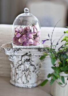 Cloche with rose petals