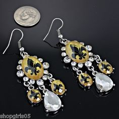 NEW!  CRYSTAL FLEUR DE LIS SILVER, GOLD AND BLACK COLOR  EARRINGS WOULD LOOK GREAT WITH YOUR SAINTS OUTFIT!! ALSO WOULD  MAKE A GREAT GIFT .  REALLY CUTE!!