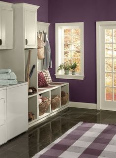 Benjamin Moore Kalamata, one of the best purple paint colours. Shown in laundry room with cream trim