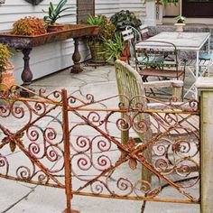 Dramatic Entrance Hinge an old garden gate between a pair of wood posts to define your patio entry. Ornate wrought-iron gates like this one . Outdoor Walls, Outdoor Rooms, Outdoor Gardens, Outdoor Living, Outdoor Decor, Old Garden Gates, Porch Gate, Plant Table, Wrought Iron Gates