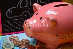 piggy bank and drawn vehicle