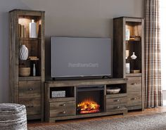 Trinell - Trinell Entertainment Center with Fireplace by Signature Design by Ashley. Get your Trinell - Trinell Entertainment Center with Fireplace at Furniture World (WA), Marysville WA furniture store. Wall Units With Fireplace, Fireplace Console, Fireplace Inserts, Fireplace Ideas, Fireplace Poker, Fireplace Wall, Media Fireplace, Brick Fireplaces, Cottage Fireplace