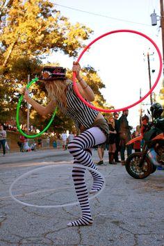 http://tutta.hubpages.com/hub/hula-hoop-tricks