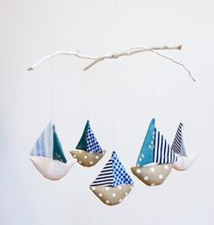 Handmade mobile with five patchwork boats with spinning sails, suspended from painted white twigs. All mobiles are made using new cotton fabric. Baby Kind, Baby Love, Baby Crafts, Crafts For Kids, Nautical Mobile, Nautical Theme, Craft Victoria, Deco Marine, Hanging Mobile