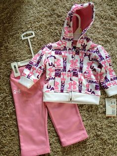 Baby Under Armour. Too cute, I can't wait to have kids in the future:) (and get to dress them up...lol)