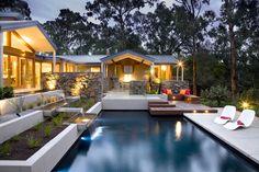 The pool area at dusk at Eltham, Australia by TLC Pools & Landscape