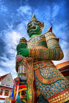 Giant statue at Wat Arun in Bangkok of the top attractions.