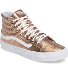 Shimmering bronze leather gives this high-top skate shoe from Vans a rich update—wear it with everything from denim to dressier ensembles for a stylish, sporty-chic look.