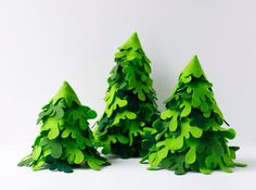 Set of three green firs. Made in felt, each firs has a little weight at the base to ensure stability. Original centerpiece in a combination of shades of green. The approximate sizes, the smallest tree: 14 cm. (6 inches) high / 10 cm. ( 4 inches) diameter base. the medium tree: 18 cm. (8 inches) high / 12 cm. (4,5 inches) diameter base. the tallest tree: 24 cm. (10 inches) high / 12 cm. (4,5 inches) diameter base.  Ready for shipment The entire collection of trees can be seen in the section…