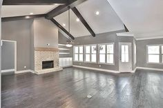 Plan Bright and Airy Craftsman House Plan Gorgeous family room. I love grey walls, white trim & hardwood floors. This space is even more stunning with the brick fireplace, wood mantel and wood beams! House Design, House, Building A House, Home Remodeling, Grey Walls, New Homes, Craftsman House, Craftsman House Plan, Home And Living