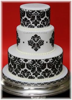 Love this vintage demask patterned wedding cake in black and white...I wonder if I could convert to cupcakes...