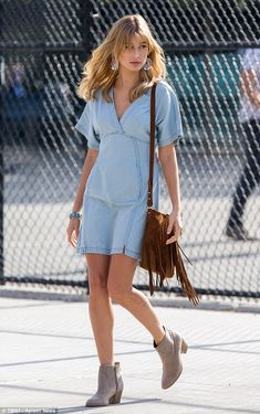 Denim diva: Hailey Baldwin looked gorgeous as she posed in a photoshoot in New York on Wed...
