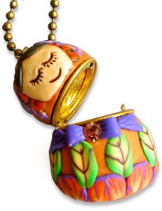Enlivened lockets - covered at 90 degrees to allow them to open like real Matryoshka Dolls! - from Polymer Clay Daily