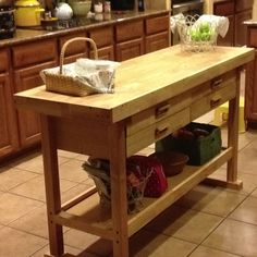 Simple kitchen island made from a woodworking bench.  My hubby hacked it into a wonderful kitchen island.  Bought it from Harbor Freight for $159.00!!  Couple of modifications and voila...