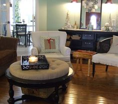 This girl took an old coffee table that had a broken glass top and turned it into an ottoman - smart idea!