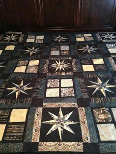 Jolene Oister - the fabric is Robert Kaufman's Lumina Dawn. The pattern is my own I put together to use my jelly rolls & charm squares. The 2 star patterns are paper pieced - they were part of a Moonglow quilt pattern.
