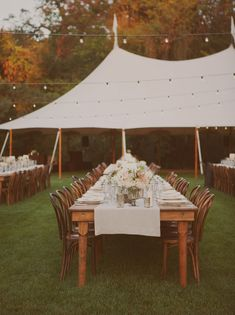 the reception party for true love.  white tents, strung lights + a beautiful feast.