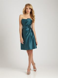 A short, strapless satin dress with pleating detail on the bodice and a flower detail at the waistline.