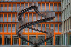 Completed in 2004, Umschreibung (or rewriting) is a surreal spiral steel staircase built by Danish-Icelandic artist, Olafur Eliasson. The staircase resides permanently in the courtyard of the global accounting firm KPMG in Munich. You may remember Eliasson's name from his New York City Waterfalls project back in 2008, where the artist created four man-made waterfalls in the New York Harbor, one being directly under the Brooklyn Bridge that was around 100 feet tall.