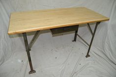 This Vintage Industrial Table was made by our in-house designer and creator. Using a butcher block wood top and a reclaimed industrial work bench
