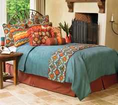 Mayan Medallion bedding exclusive from Crow's Nest.  A lively play of color & pattern, modern & upbeat in Southwest shades of turquoise, blue chambray, orange & gold.