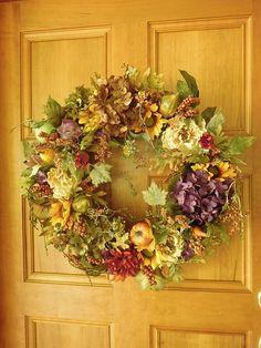 Fall Wreath , Autumn Wreath , Fall Door Wreath , Woodland Wreath , Wreath , Thanksgiving Wreath , Harvest Wreath , Rustic Wreath ***************************original design was created for the 2016 season************* This beautiful design took on a life of its own, It was inspired by the beautiful fall flowers, berries and pumpkins. Its sure to enhance your front door or any where in your home measurements = the bulk of this wreath measures 23 to 24 To see my entire collection of wrea...