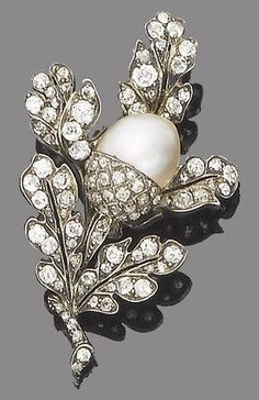 A Victorian pearl and diamond brooch, circa 1870. The realistically modelled spray of old brilliant, single and rose-cut diamond oak leaves around a central pearl acorn, old brilliant and single-cut diamonds. #Victorian #antique #brooch
