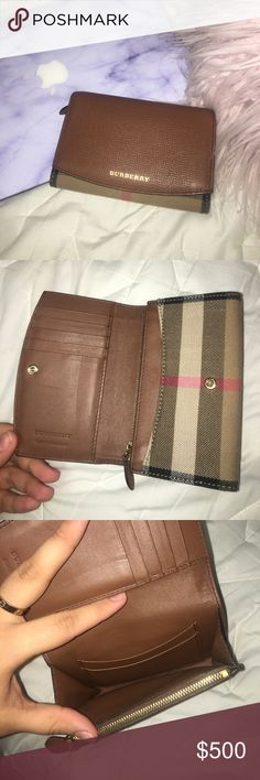 Authentic Burberry Wallet! This wallet is gently used and is in great condition. I bought this last year in Europe and i'm looking to sell! Its practically brand new except a little dent from where the zipper lays on the leather. Comes with original dust bag and shopping bag! Willing to negotiate price. Burberry Other