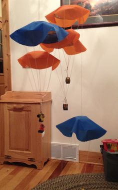Disney Planes Fire & Rescue parachute decorations or toys, made with mini pie tin, nylon and thread. The tiny smokejumper toys are cake toppers from amazon.