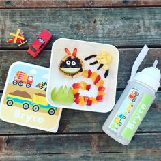 A simple fun afternoon snack- great for picky eaters... even our fruity caterpillar snack is delighted!  We adore our @bright.star.kids lunchbox and bottle... and my little man is chuffed as punch that his name is printed on them- alongside all those awesome trucks diggers and mixers!  They also have 30% off until midnight tonight...  #picnic #foodart