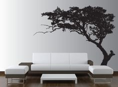 Interior. Agreeable Minimalist Large Dark Brown Tree Wall Decal Living Room Decor Plus Two Tone Colored Couches Abd Ottoman By Using Polished Chrome Metal Frame Base Also White Wooden Low Coffee Table On Wooden Parquet Floor With Cheap Wall Art Plus Home Wall Decor. Cool Inspiration For Decorating The Walls Of Your House To Make It Look Attractive Without Taking Up Much Space